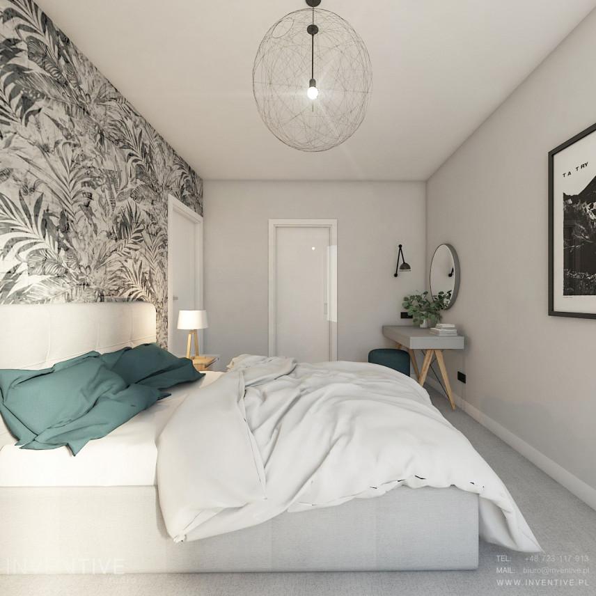 Sypialnia w stylu skandynawskim z toaletką.