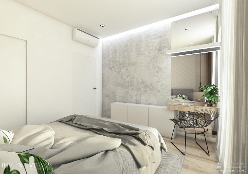 Sypialnia z jedna ścianą w betonie dekoracyjnym