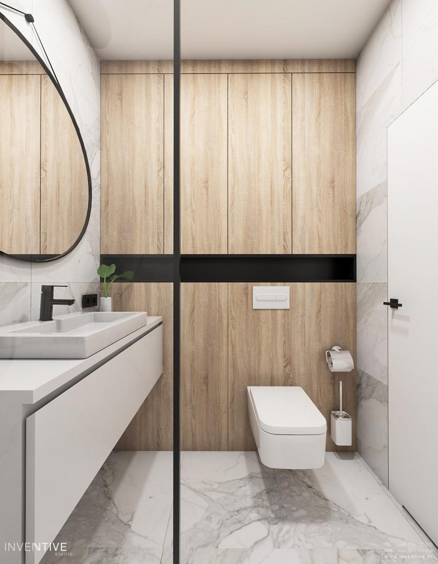 Łazienka z drewnianą ścianą