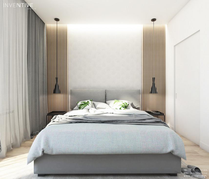 Sypialnia z elementami drewna na ścianie