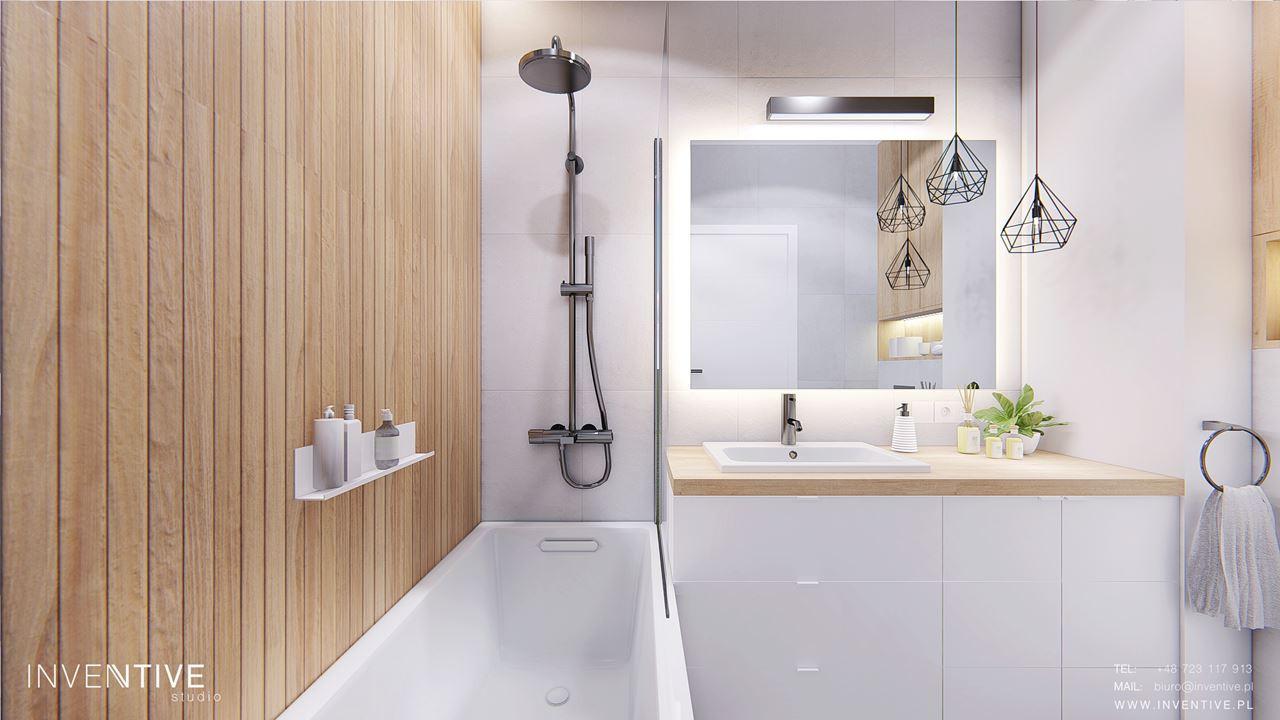 Mała łazienka z drewnianą ścianą