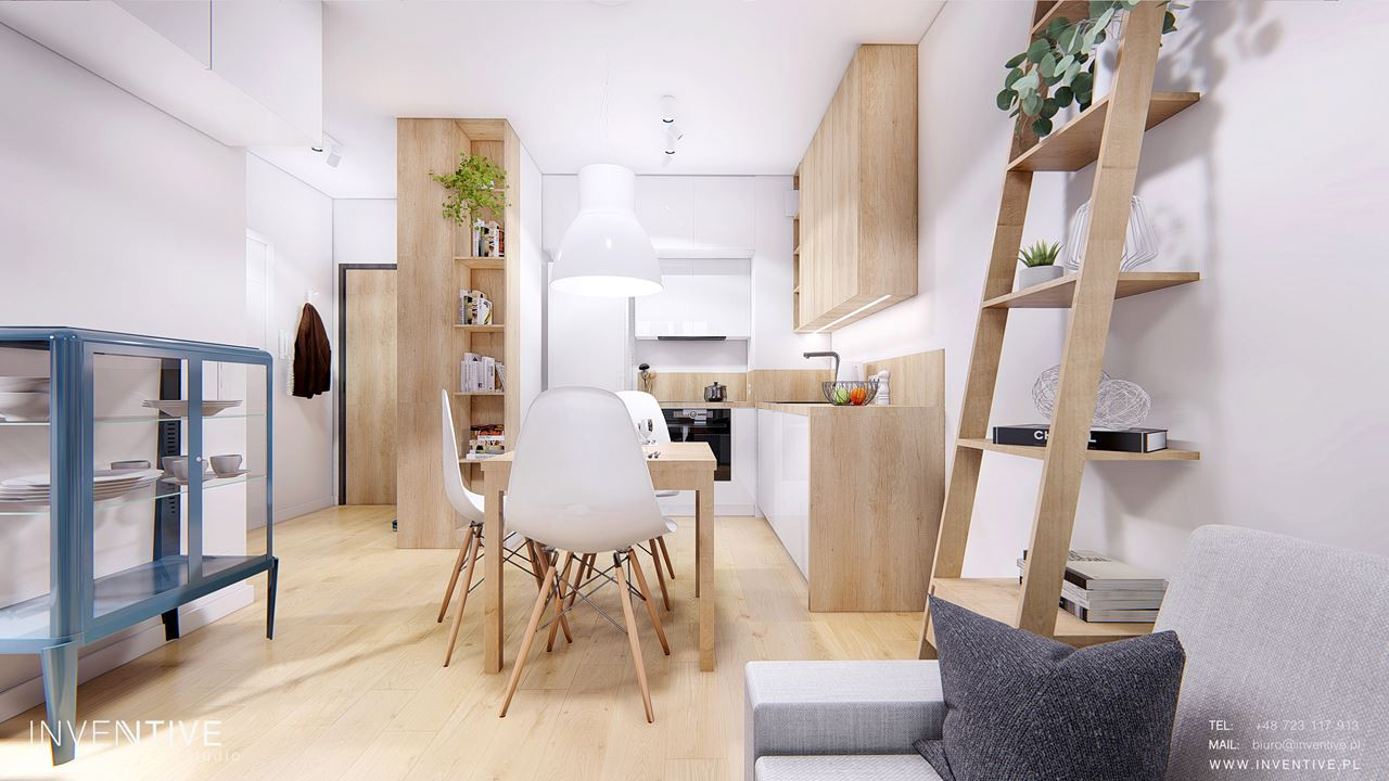 Niewielki salon w kolorze białym z drewnianymi meblami