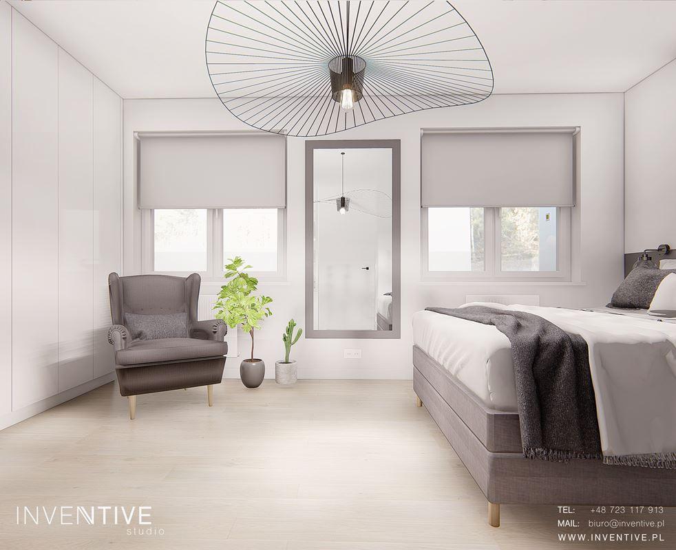 Projekt sypialni z designerską lampą