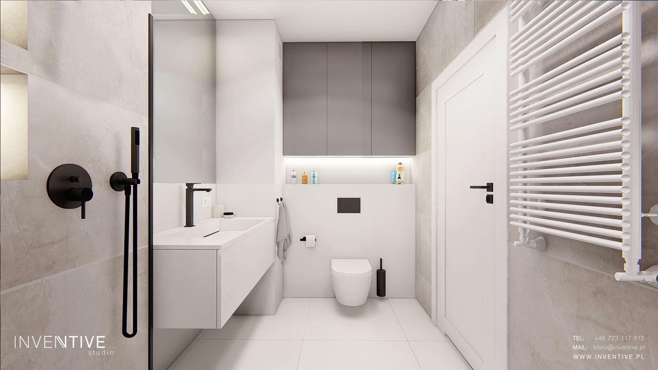 Łazienka z prysznicem i muszlą wiszącą