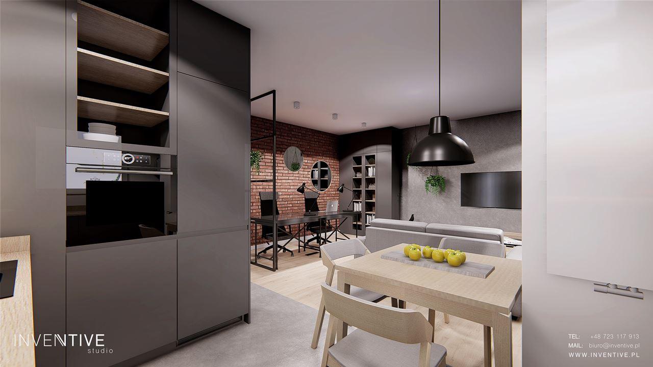 Widok z kuchni na salon  w stylu loft