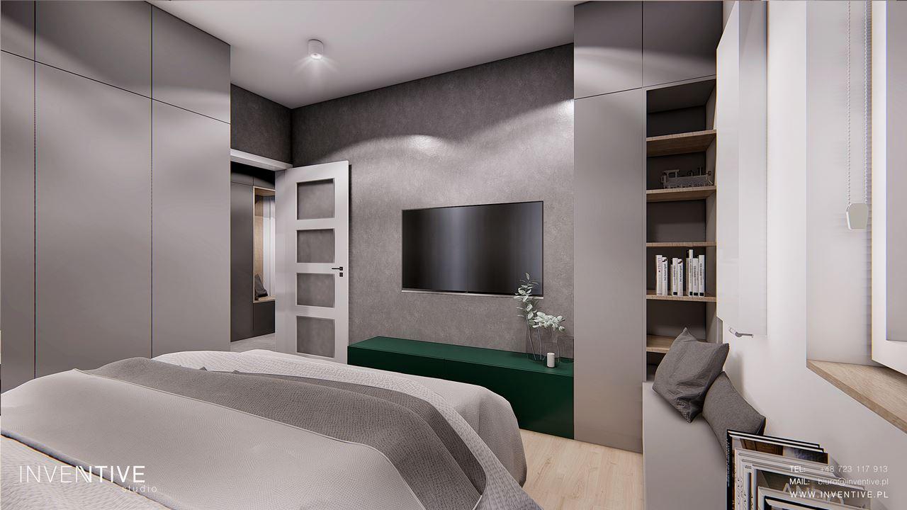 Loftowa sypialnia z betonową ścianą i telewizorem