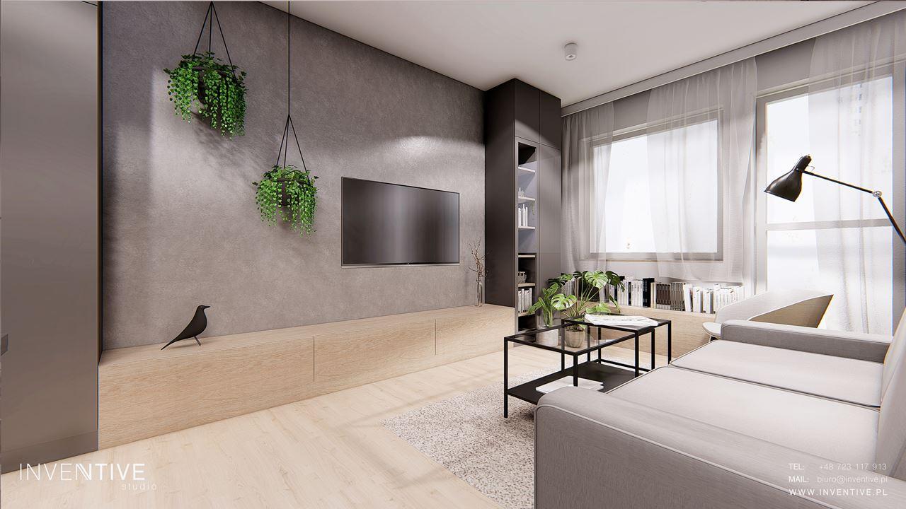 Szary salon z betonową ścianą na telewizor