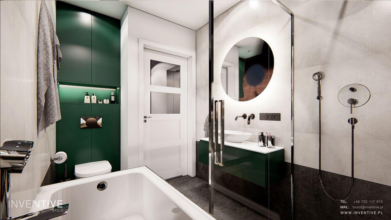 Łazienka z zielonymi szafkami w stylu loft