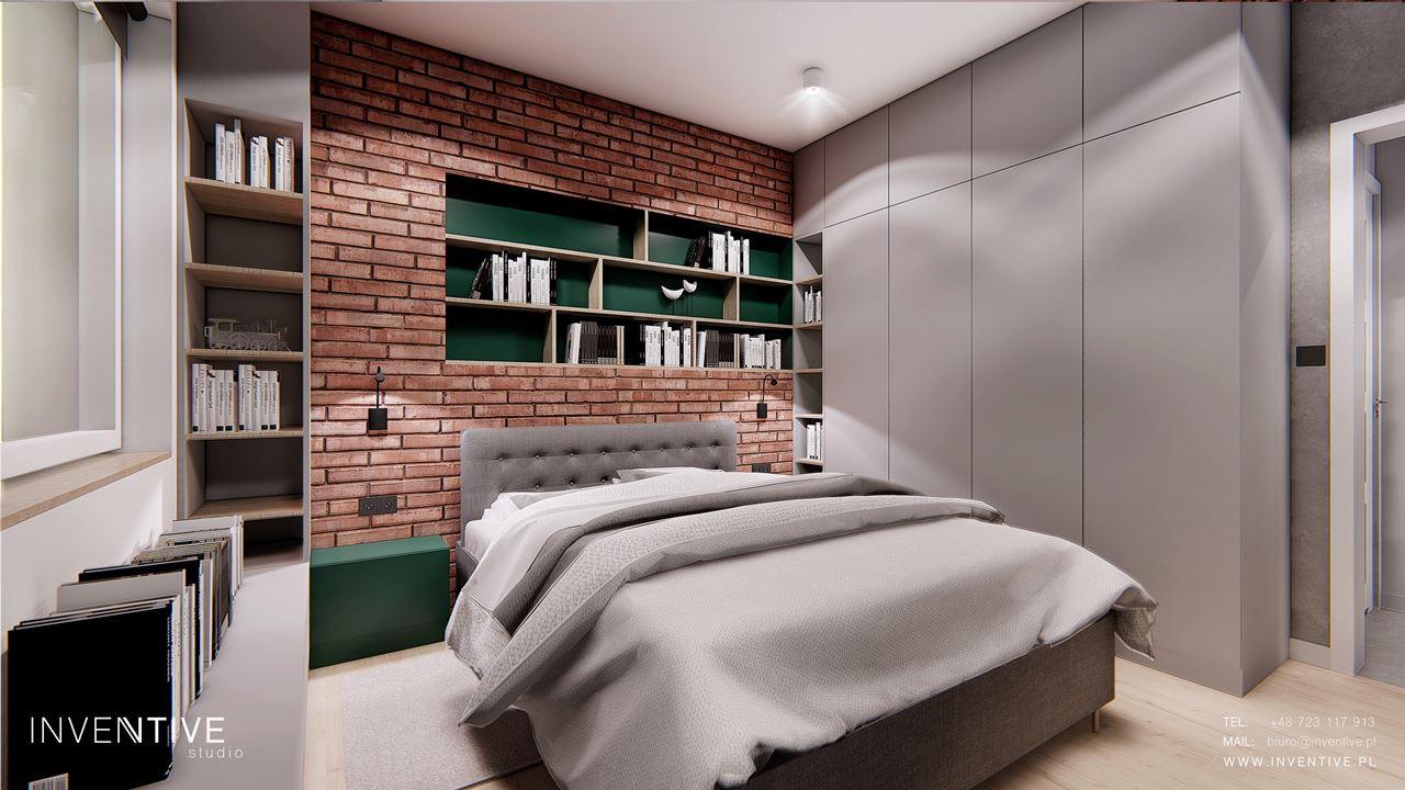 Szara sypialnia z cegłą na ścianie