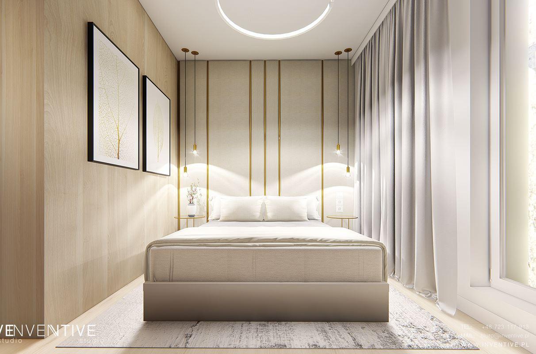 Sypialnia z drewnianym akcentem na ścianie
