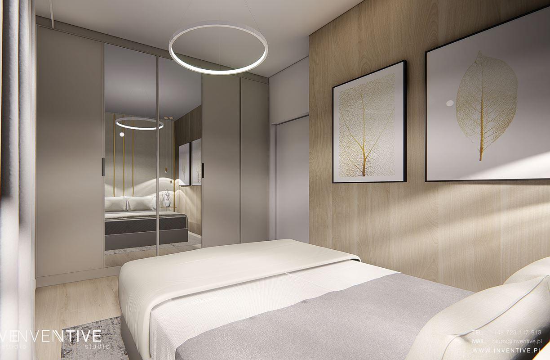 Sypialnia z drewnianą ścianą i szafą w zabudowie