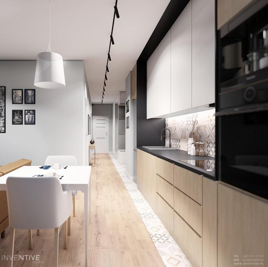 Projekt kuchni z mozaiką na ścianie nad blatem