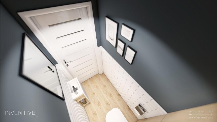 Mała toaleta z białą cegłą