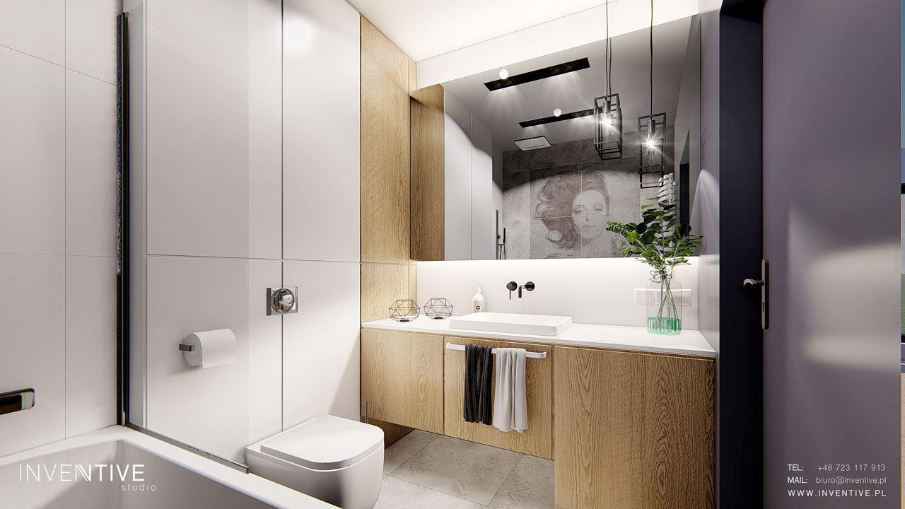 Łazienka z drewnianymi szafkami