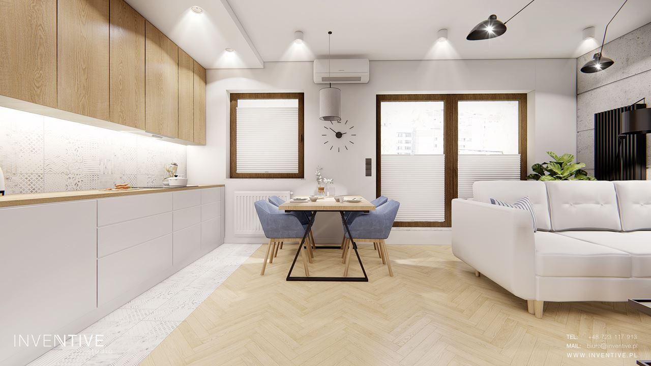 Aranżacja kuchni z salonem z drewnianym parkietem