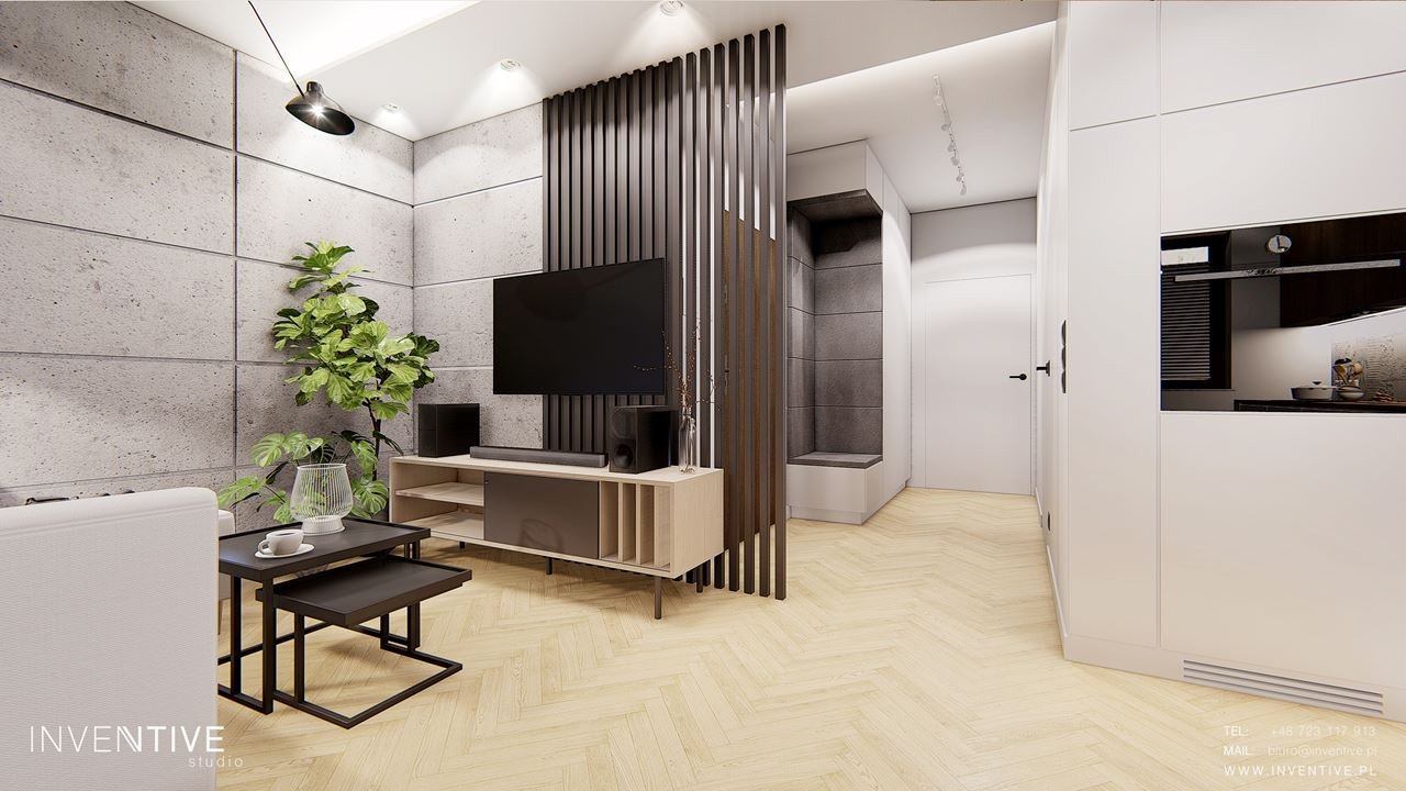 Salon z betonowymi płytami na ścianie