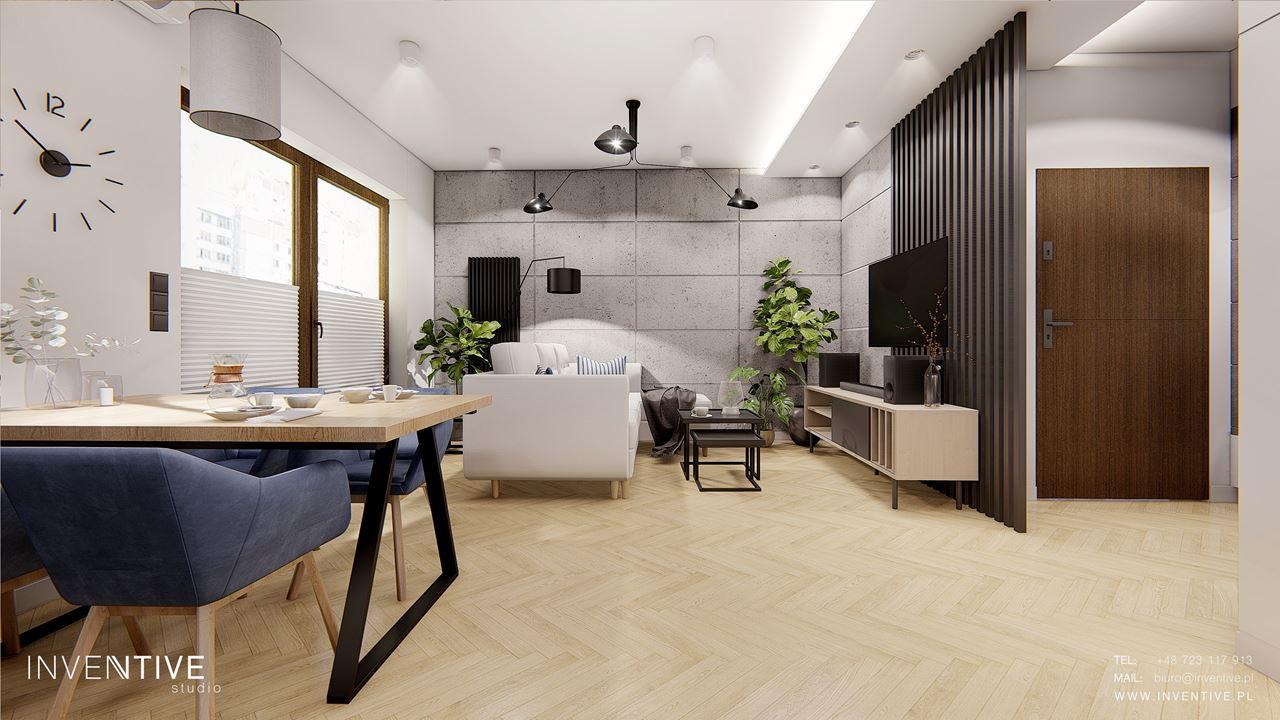 Betonowe płyty na ścianie w salonie