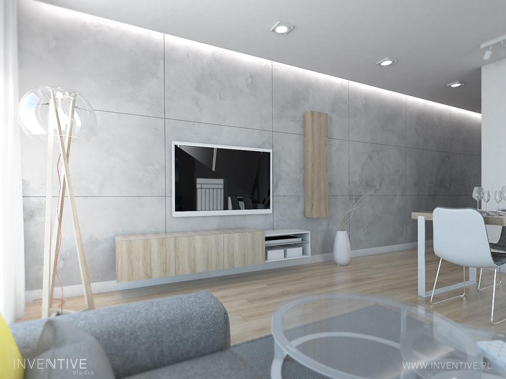 Aranżacja salonu z betonowymi płytami dekoracyjnymi