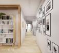 Ściana w przedpokoju z czarno-białymi fotografiami