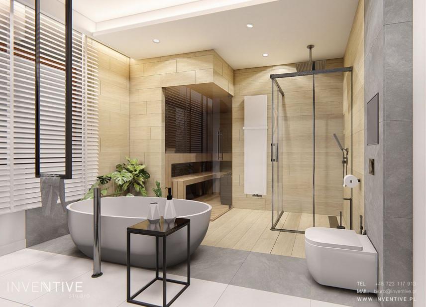 Łazienka z wolnostojącą wanną i sauną