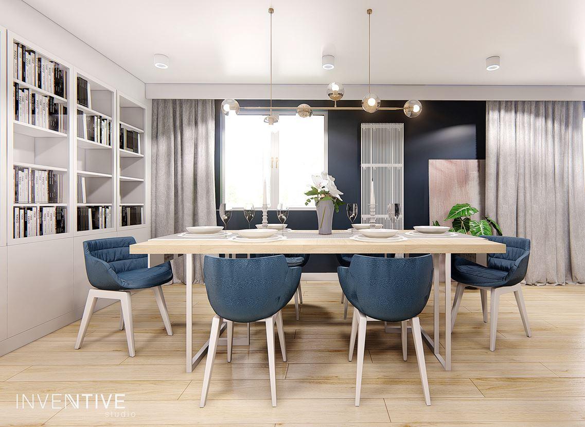 Jadalnia z niebieskimi tapicerowanym i krzesłami