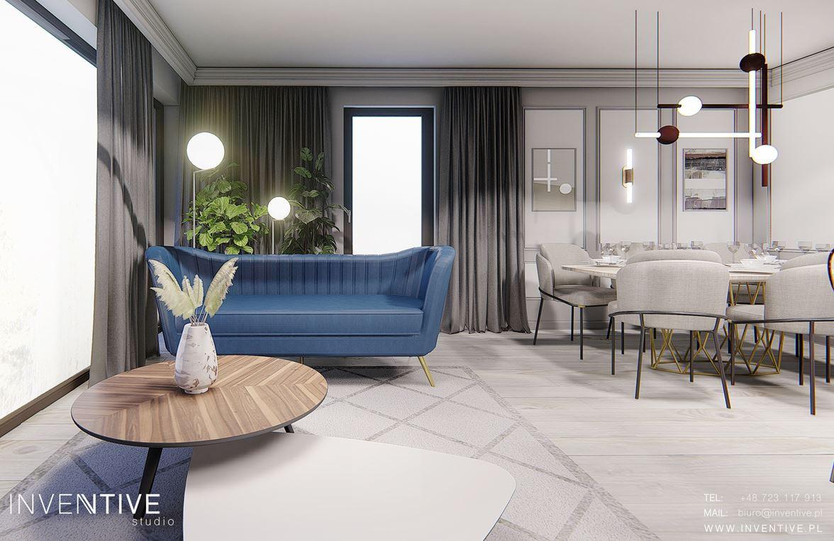 Szary salon z niebieska sofą
