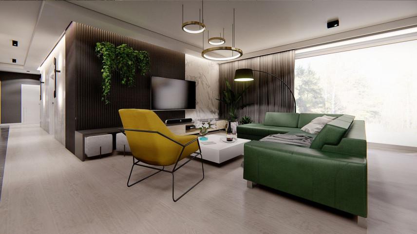 Nowoczesny salon z żółtym fotelem i zielonym narożnikiem