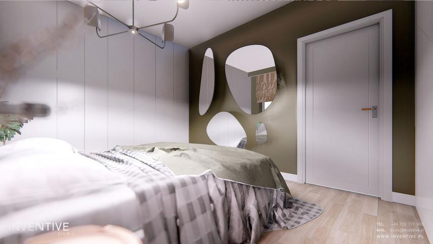 Sypialnia z oliwkową ścianą