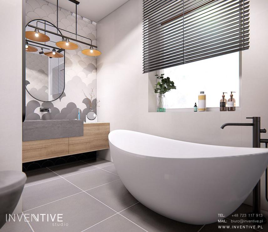 Stylowa łazienka z owalną, wolnostojącą wanną