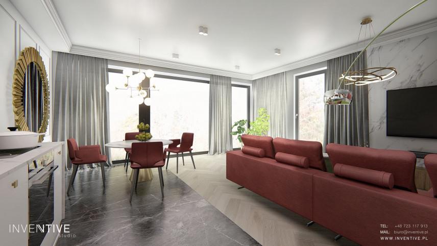 Salon w stylu Art Deco z bordowymi tapicerowanymi meblami
