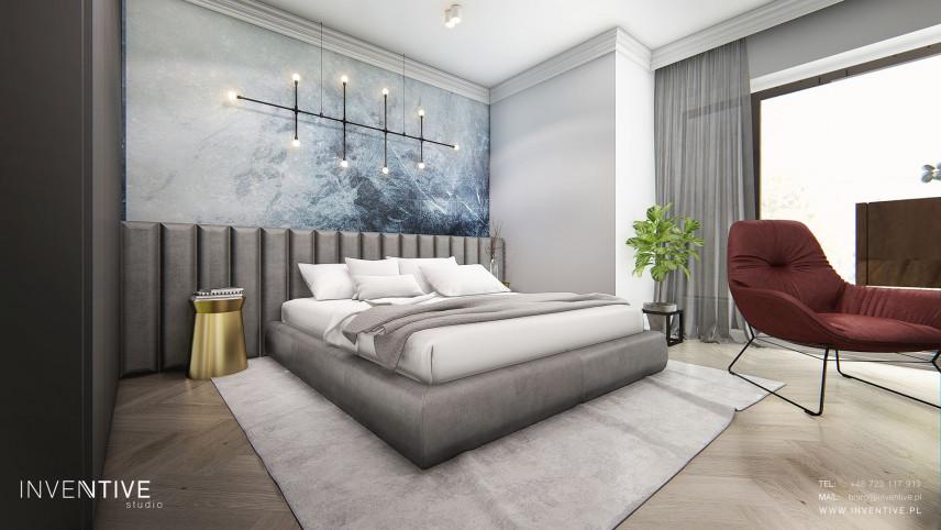 Designerska sypialnia ze stylowym żyrandolem