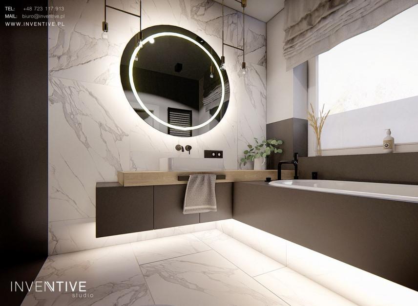 Łazienka z okrągłym, podświetlanym lustrem