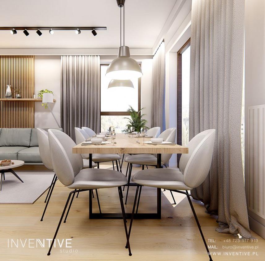 Jadalnia z nowoczesnym drewnianym stołem