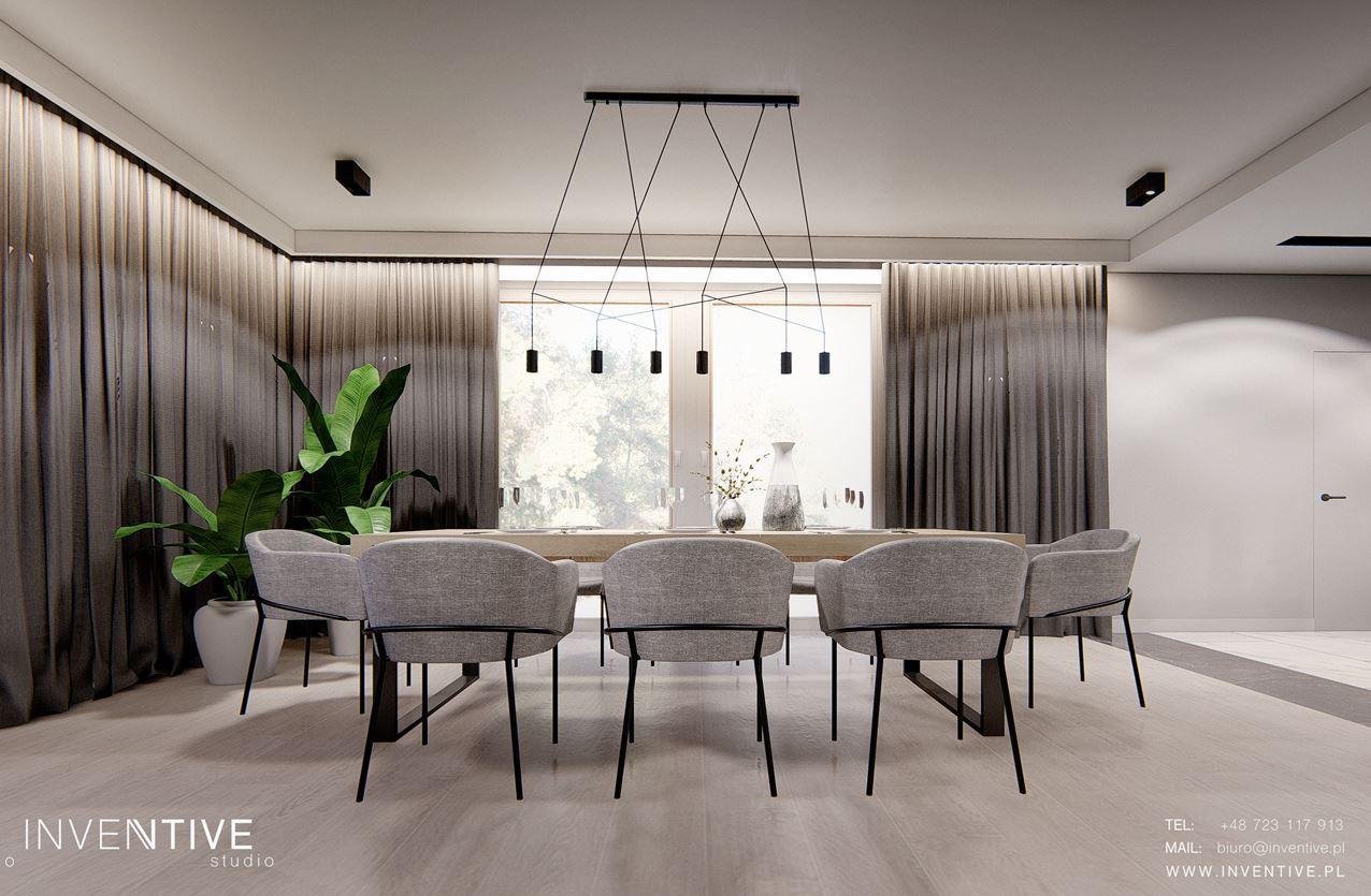Jadalnia z szarymi tapicerowanymi krzesłami