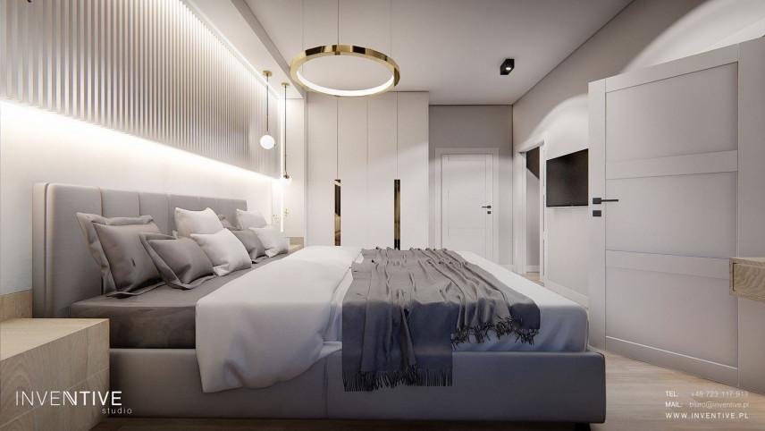 Sypialnia z szarym, kontynentalnym łóżkiem