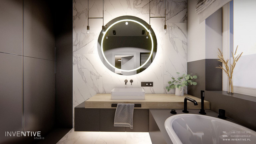 Nowoczesna łazienka z wiszącymi lampami
