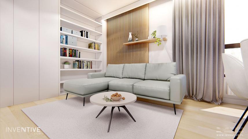 Salon z jasnym dywanem i narożnikiem