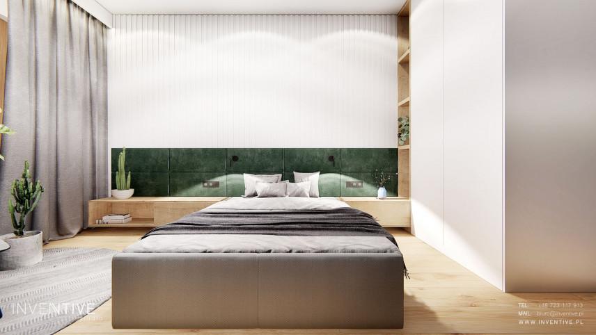 Sypialnia z dużym, tapicerowanym łóżkiem