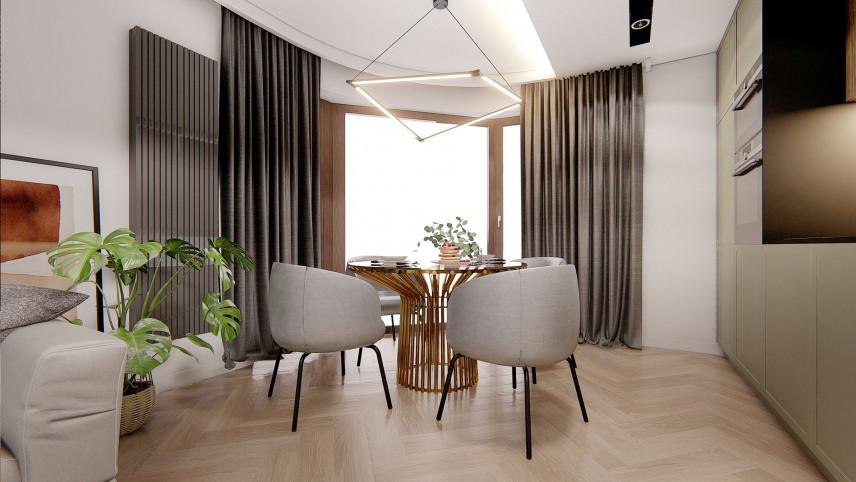 Jadalnia z tapicerowanymi krzesłami i stylową lampą