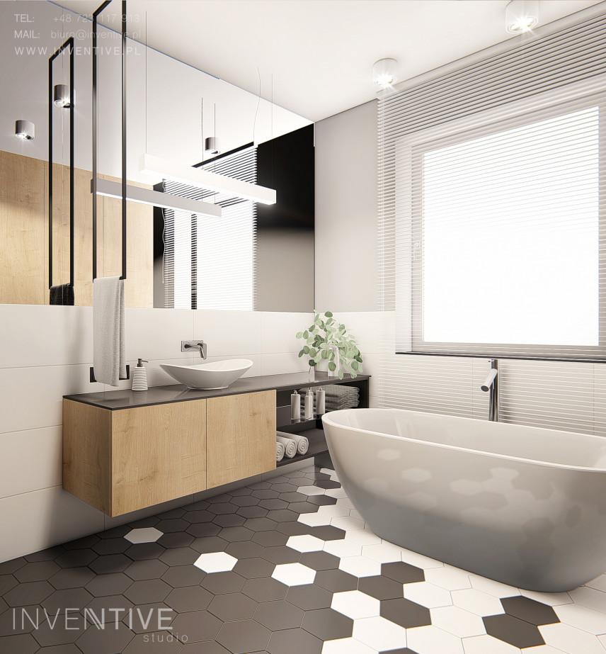 Łazienka w stylu scandi z wolnostojącą wanną