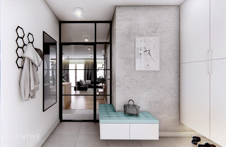 Przedpokój z betonem architektonicznym na ścianie