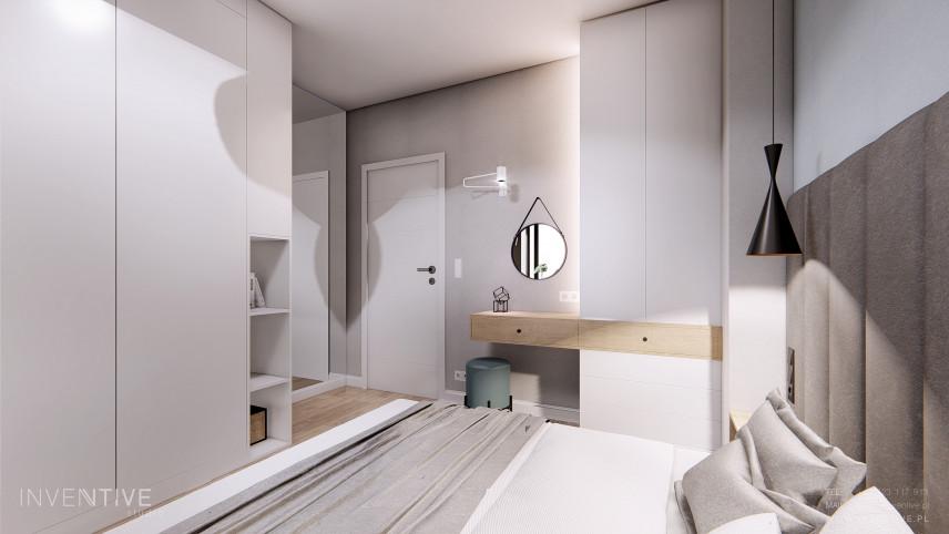 Szara sypialnia z łóżkiem z zagłówkiem