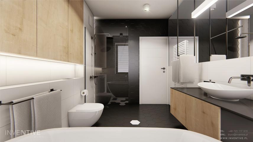 Grafitowa łazienka z drewnianymi frontami