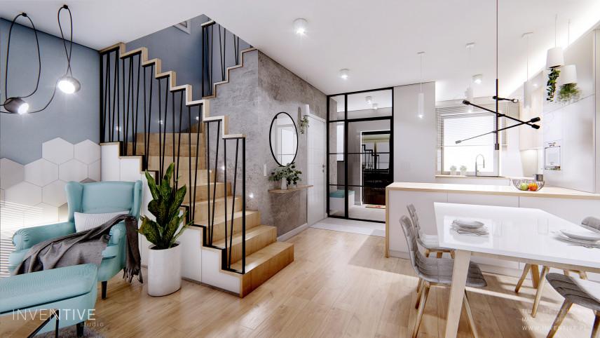 Salon w stylu scandi ze schodami