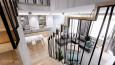 Salon z jadalnią w kolorach biało-szaro-miętowych