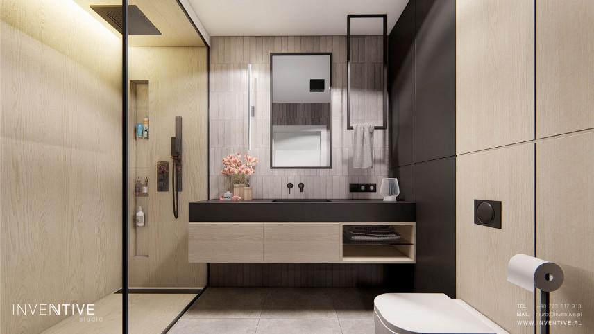 Projekt łazienki z czarno-drewnianymi płytami na ścianie