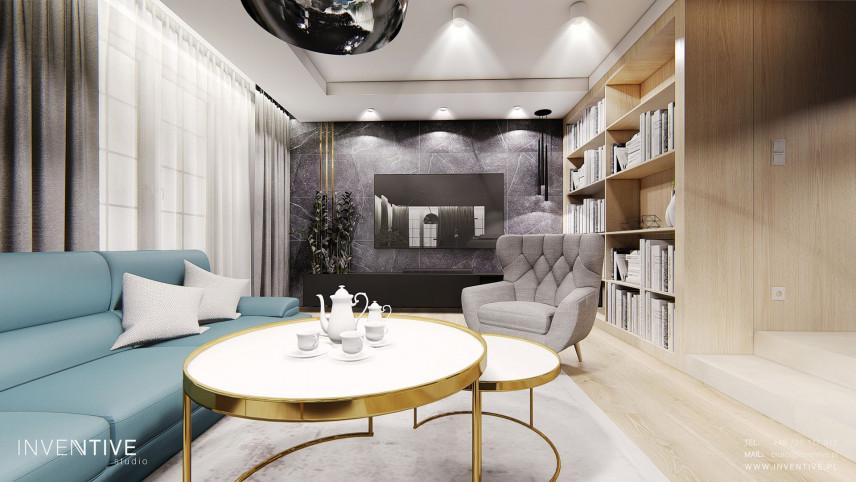 Projekt salonu z designerskim, okrągłym stolikiem kawowym