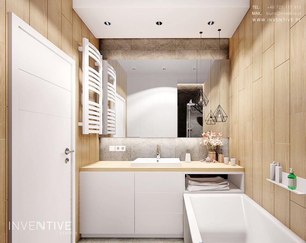 Łazienka w stylu scandi z wanną w zabudowie