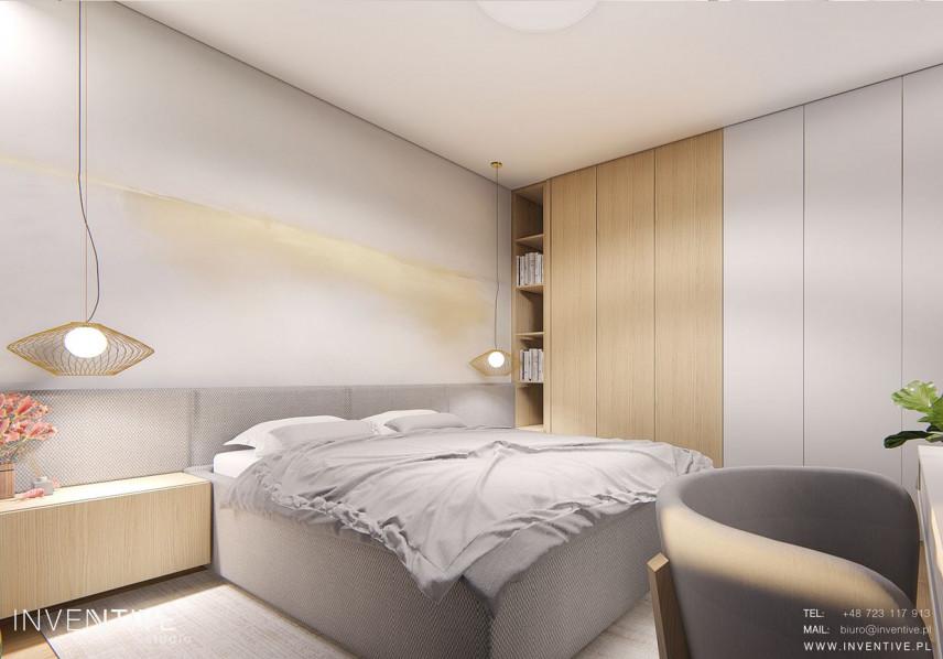 Szara sypialnia z wiszącymi lampami