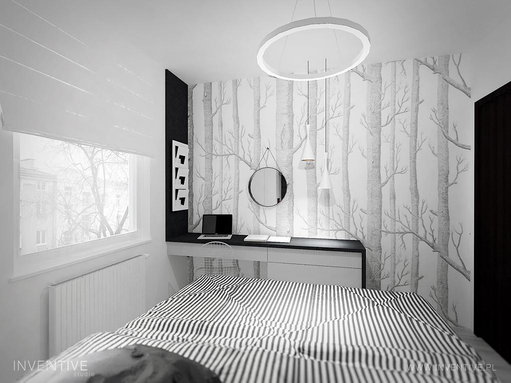 Sypialnia z czarno-białą grafiką drzew na ścianie